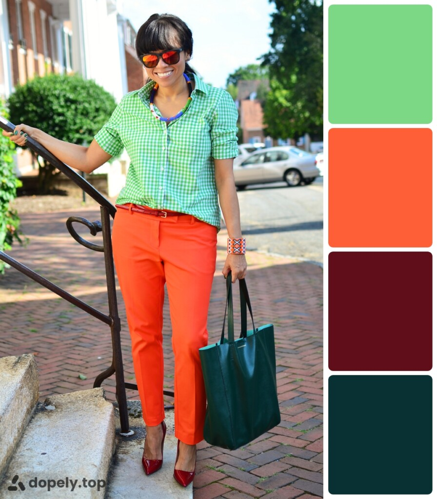 a girl standing by the stairs in orange, dark green, light green and crimson clothes. next to the color palette made of Dopely for a combination of green and orange.