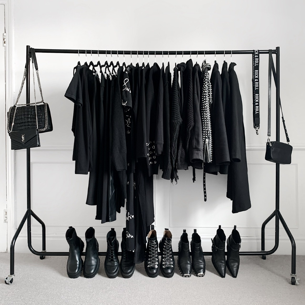 closet full of black clothes and shoes