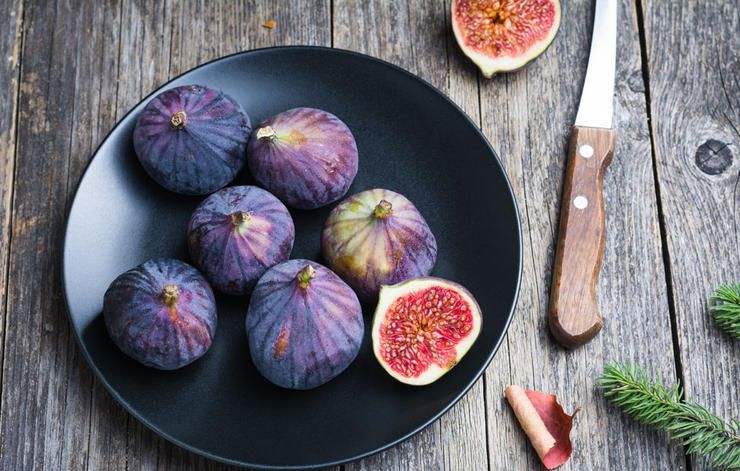 a few black figs on the plate
