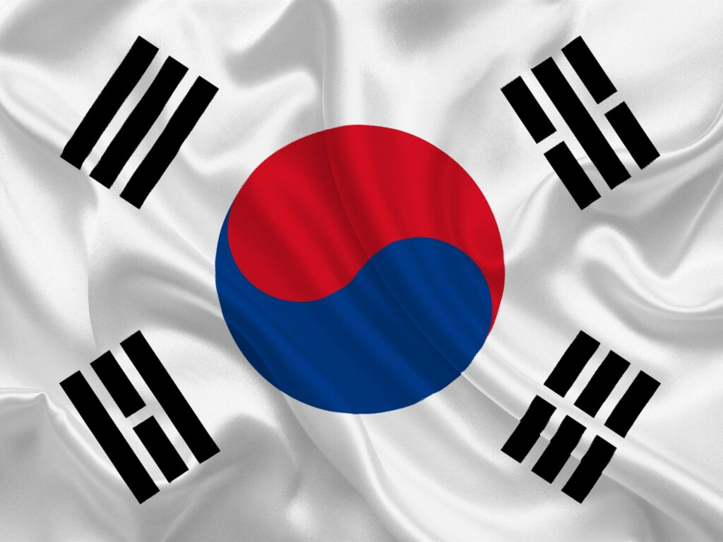 South Korea's flag with red and blue circle in the middle and four black trigrams on the white background