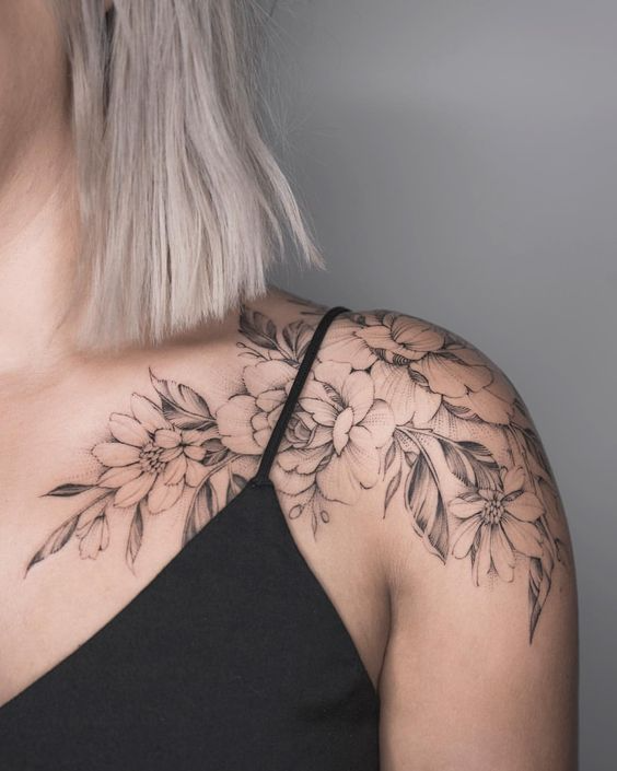 flower tattoo on the woman's shoulder