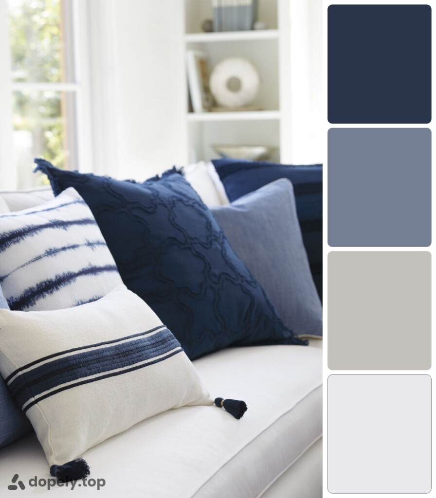 blue and white cushions on the white furniture