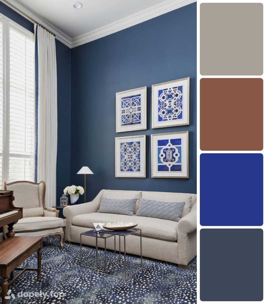 living room with blue walls and carpet, cream furniture, blue and white tableaus