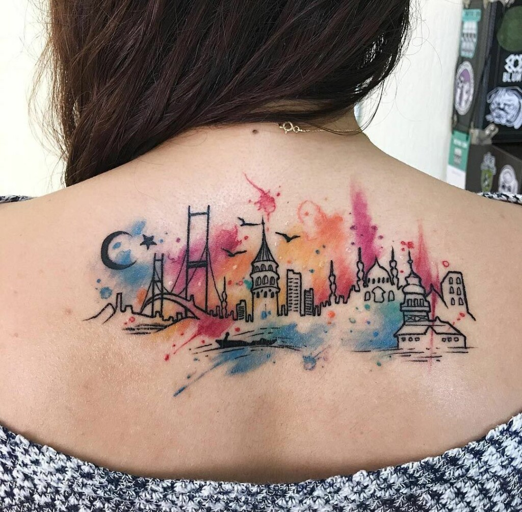 tattoo of different parts of world on the back with different tattoo colors