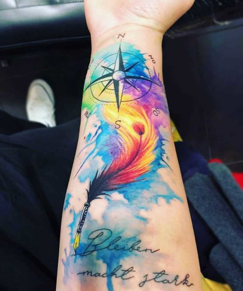 colorful tattoo of quill on the forearm with different tattoo colors