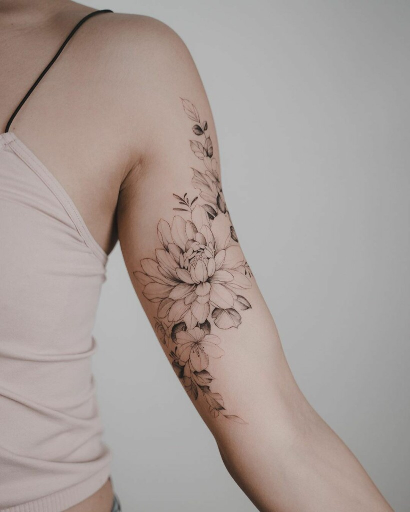 flower tattoo on the inner arm