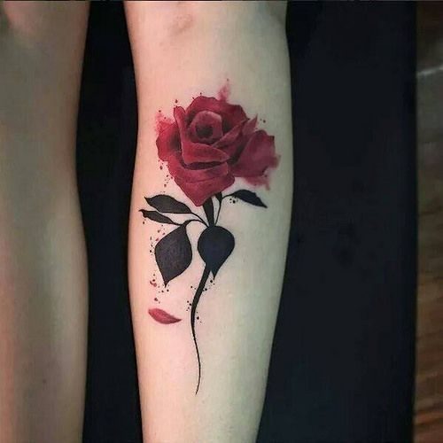 rose tattoo on the forearm with red and black tattoo colors