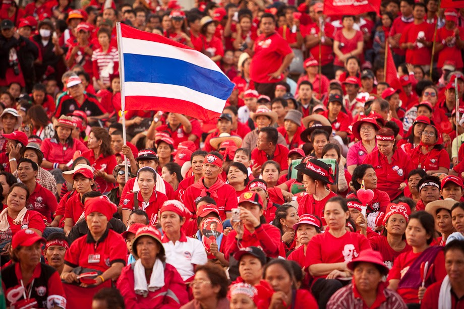 photo about Thailand's colors people wearing red thai shirts