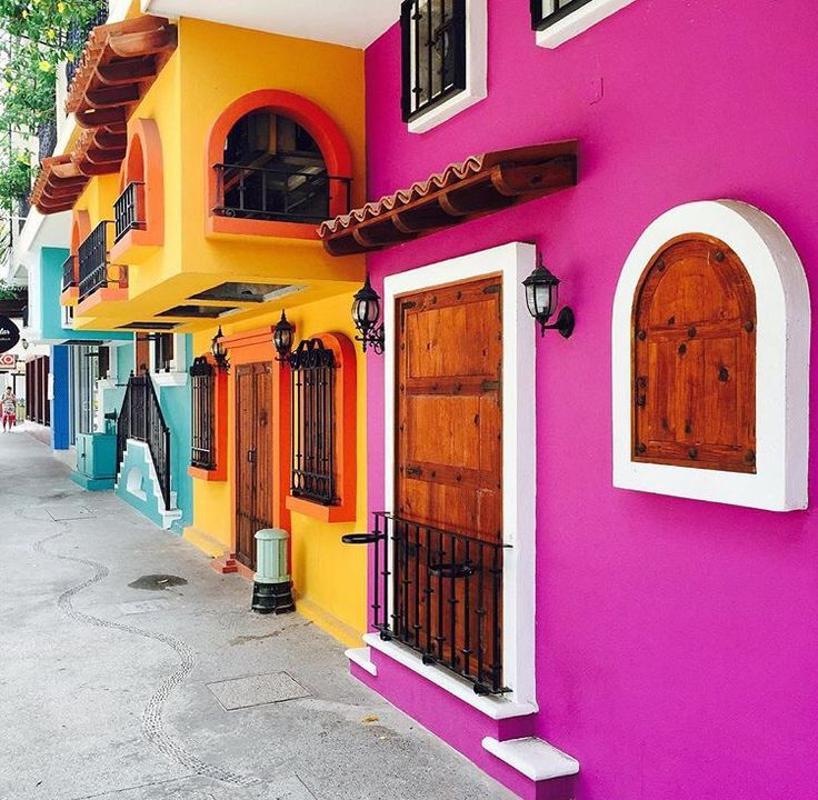view of Mexican house in pink, light orange and blue.