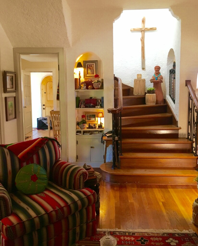 another view of the interior of a Mexican house with white walls and brown stairs.