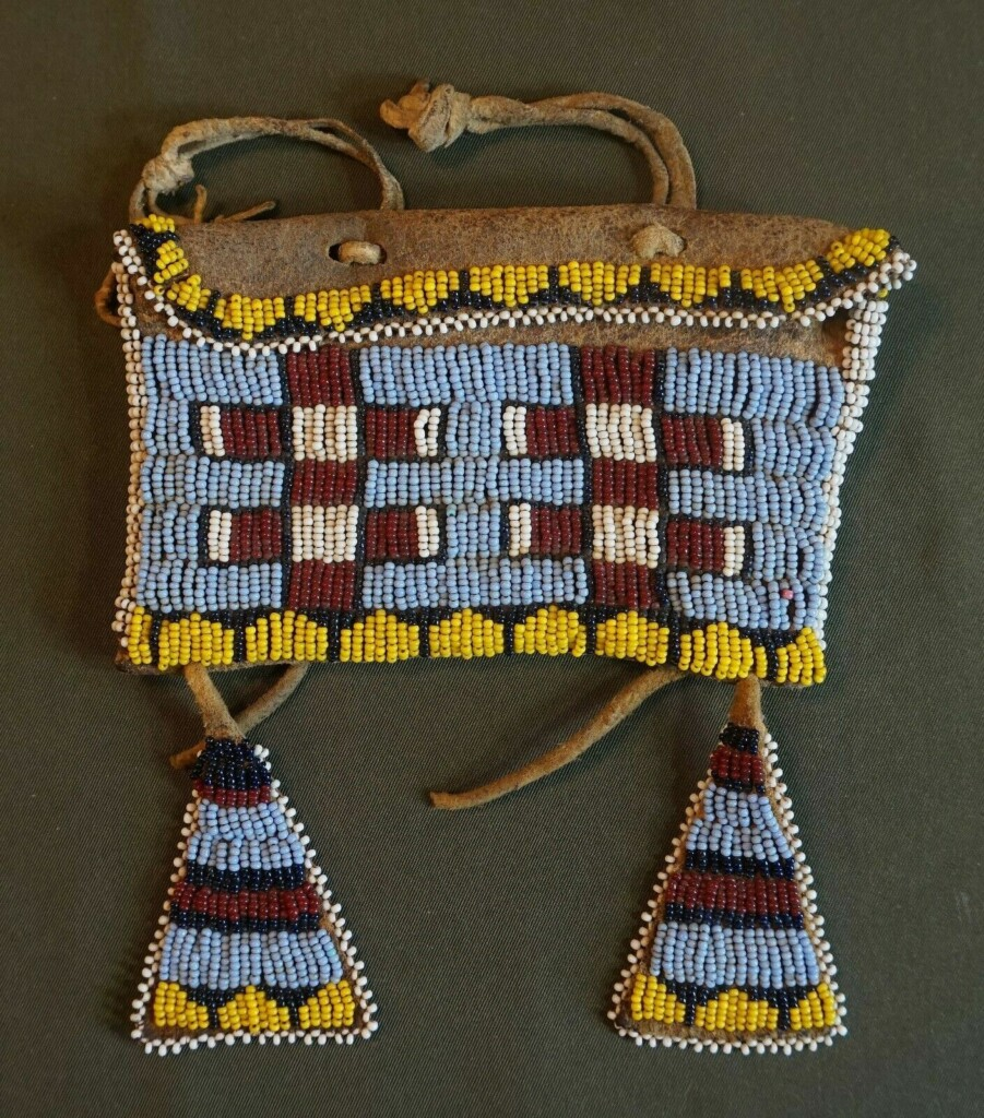 native american purse embroidered with beads.