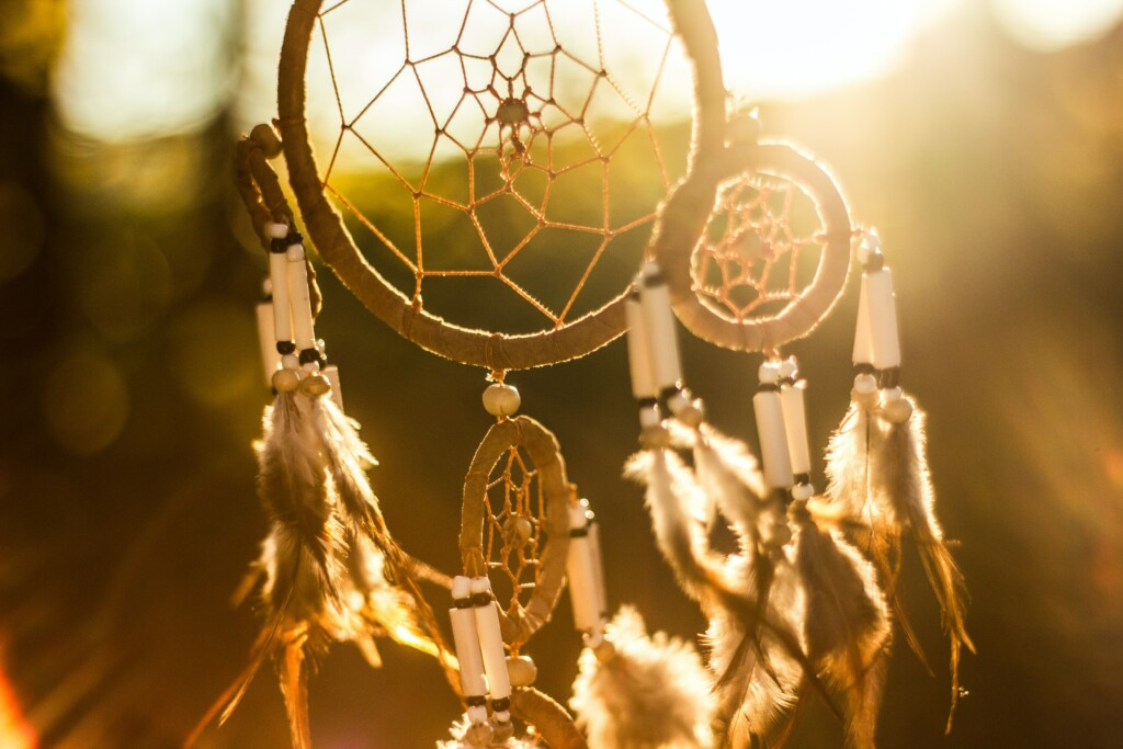 a picture of a dream catcher hanging that is important to Native American.