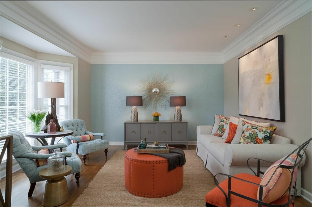 an image of a living room in which two colors, light blue and orange, have been selected for accent colors.