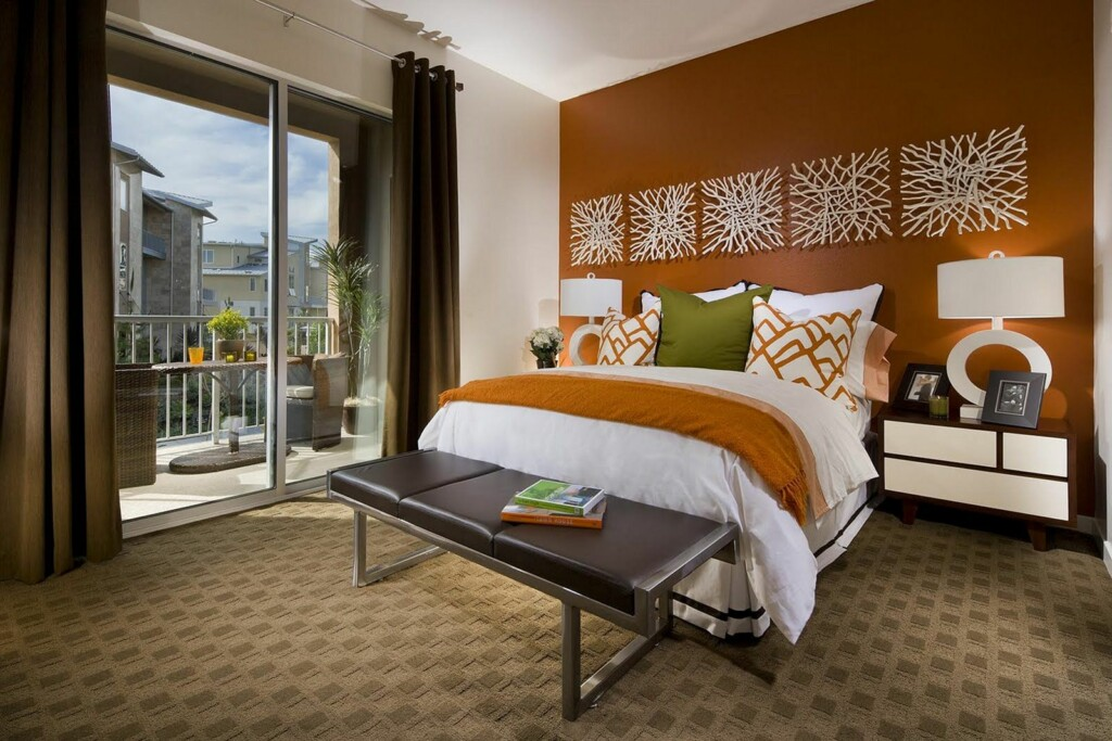 an image of a bedroom with accent colors of olive green and light brown that harmonize with each other.