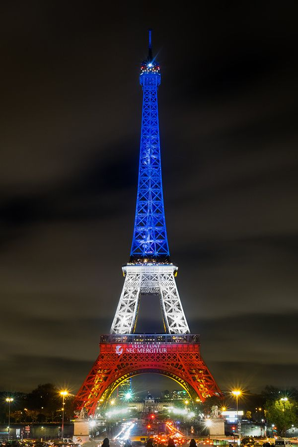 the Eiffel tower colored by France national colors: blue, red and white