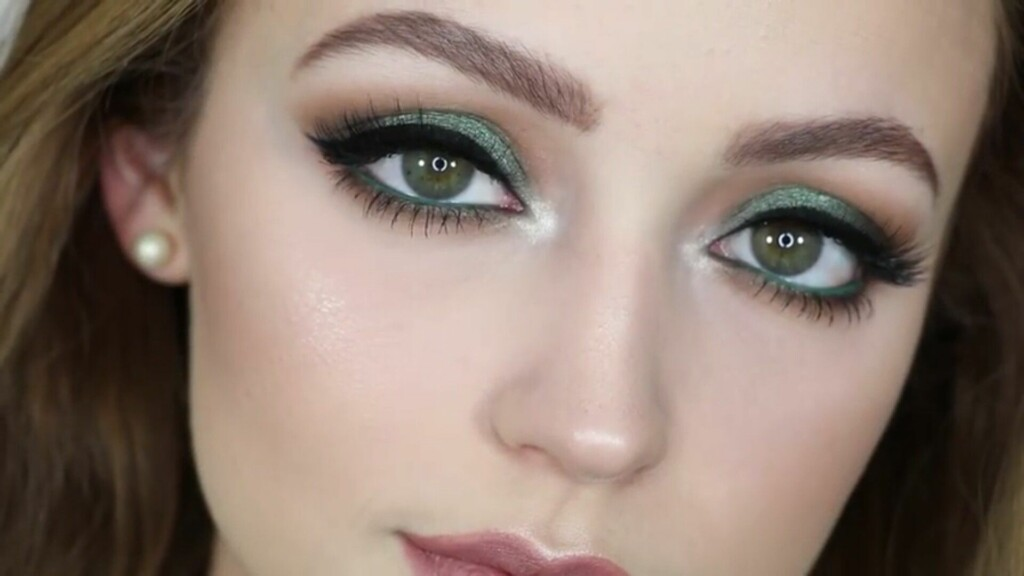 a girl with green eyes who has used a lighter shade of green color for her eyeshadow.