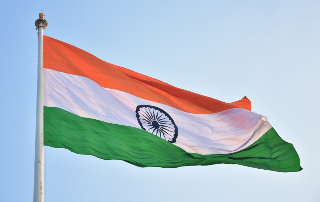 indian flag with the colors Orange, white and green. with the blue wheel in the middle of the flag.