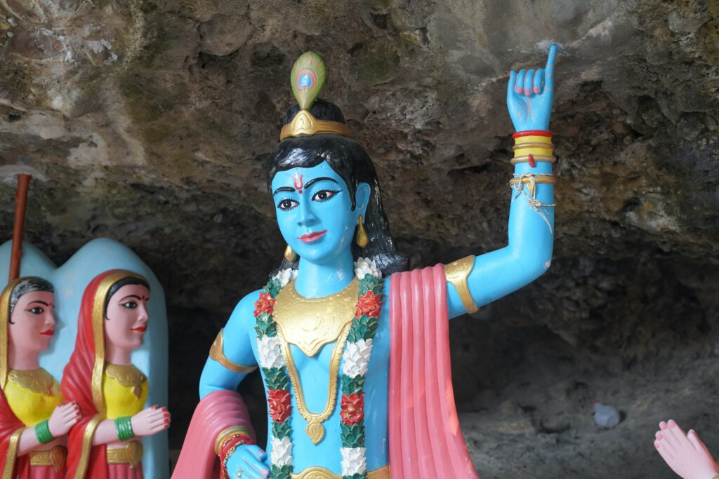 an image of Krishna, a Hindu deity, with a blue body.