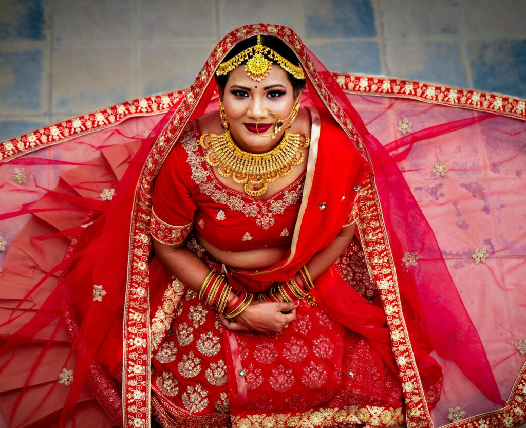 an indian bride that wear red dress. because it is considered a symbol of fertility.